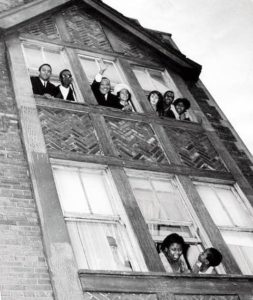 Dr. King & wife, Coretta, waving from their Chicago apartment in 1966.